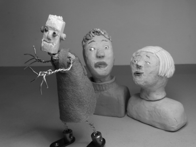 two plasticine heads and wire puppet