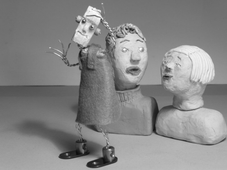 two plasticine heads and standing wire puppet