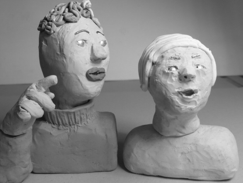 two head and shoulder plasticine puppets