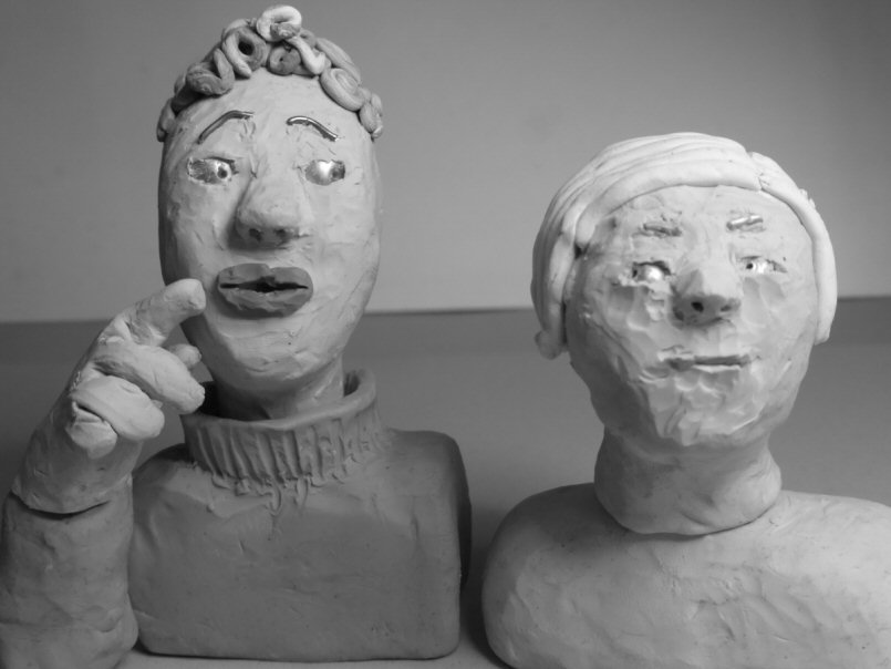 two plasticine heads
