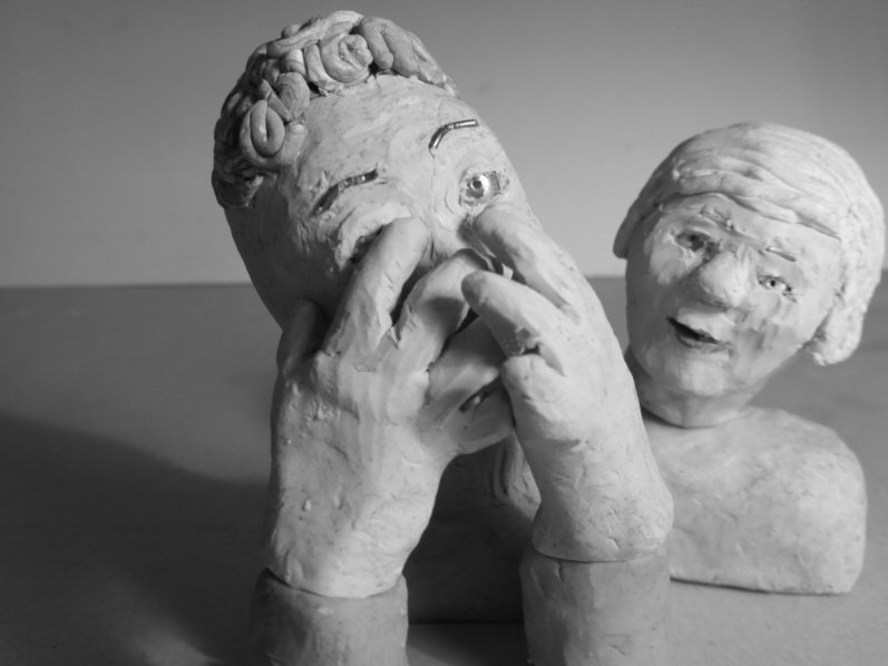 tabletop view of two puppet heads