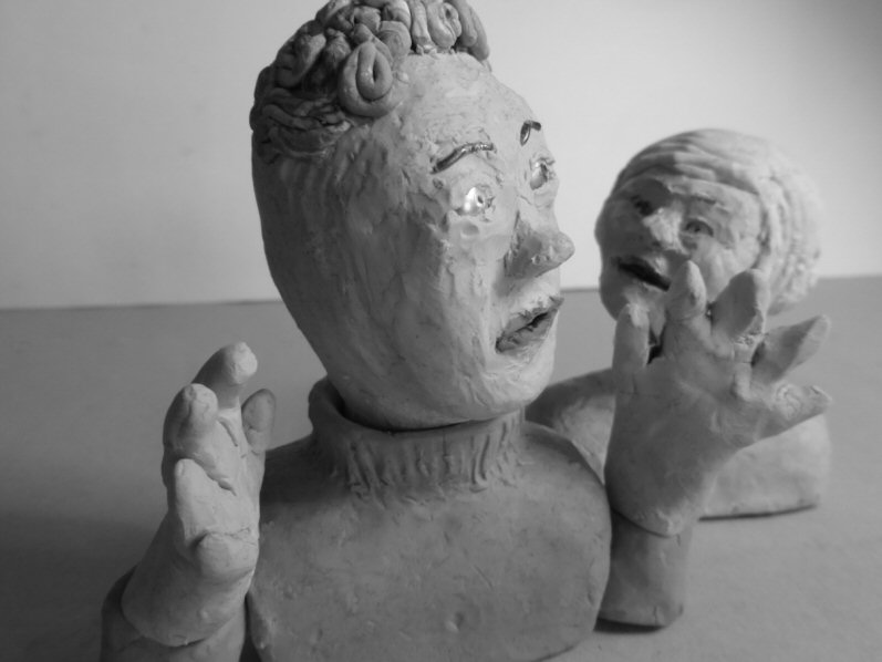 closeup of two puppet heads