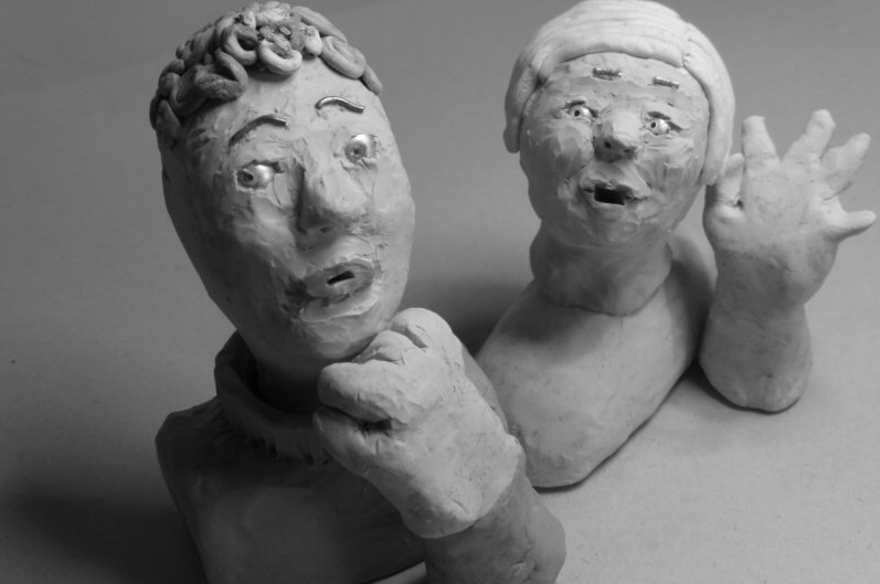 two plasticine heads looking anxious