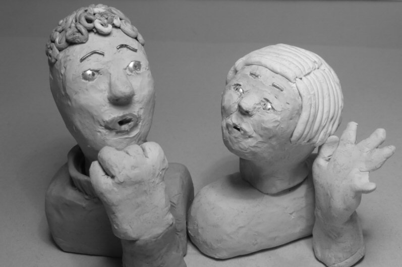 two plasticine heads looking at each other
