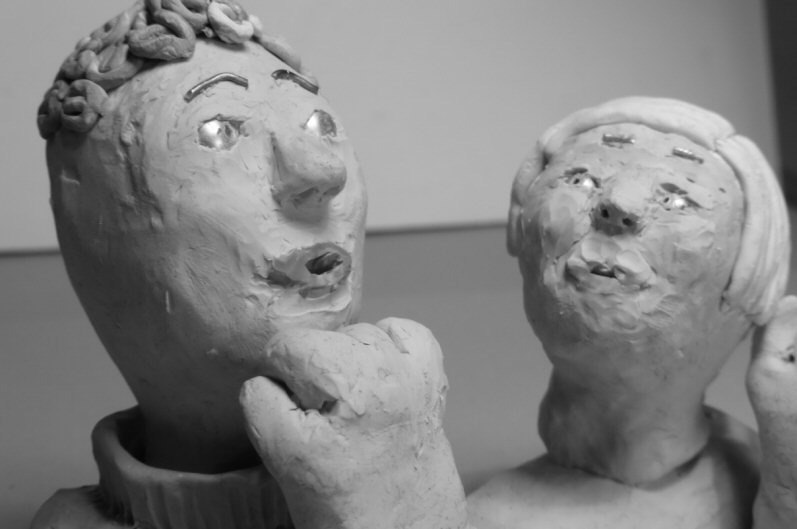 two plasticine heads three quarter view