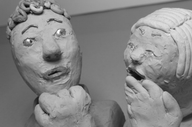 one plasticine head laughs at another