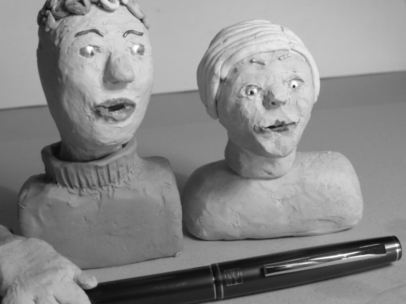 two plasticine heads and pen