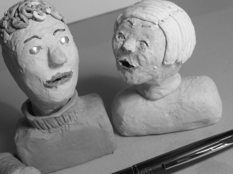 two plasticine heads talking to each other