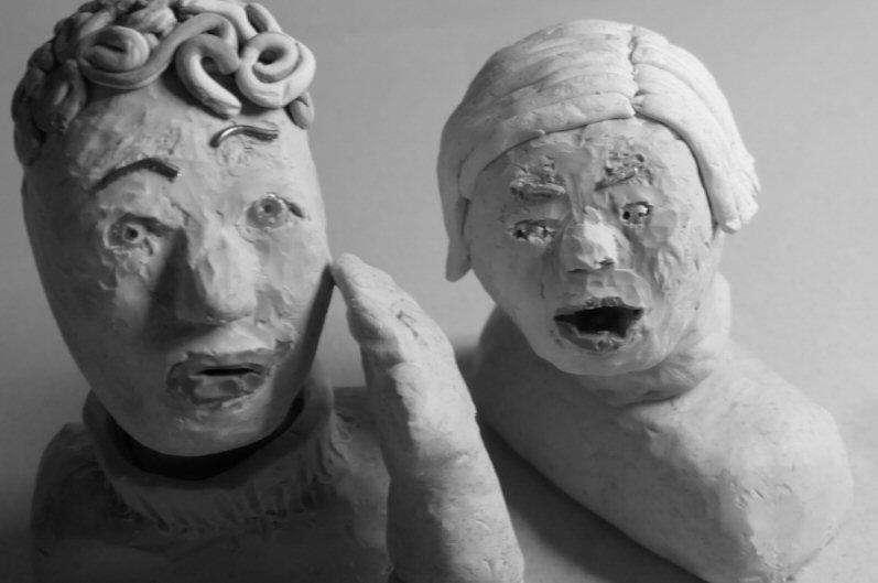 two plasticine heads