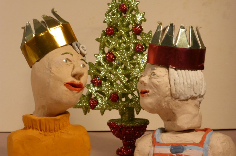 christmas tree and two plasticine heads