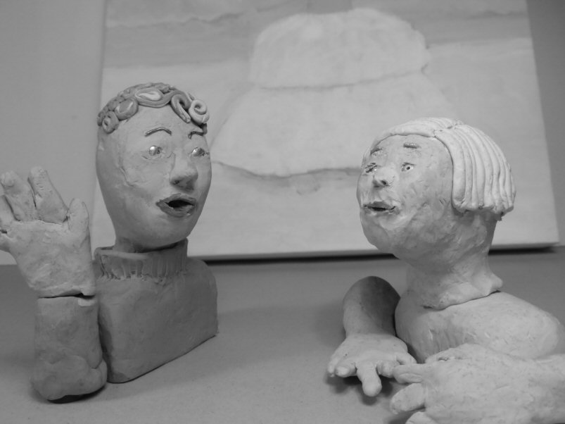 2 plasticine heads in conversation