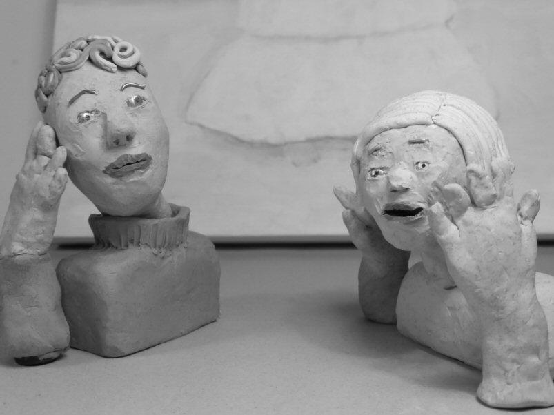 2 plasticine heads