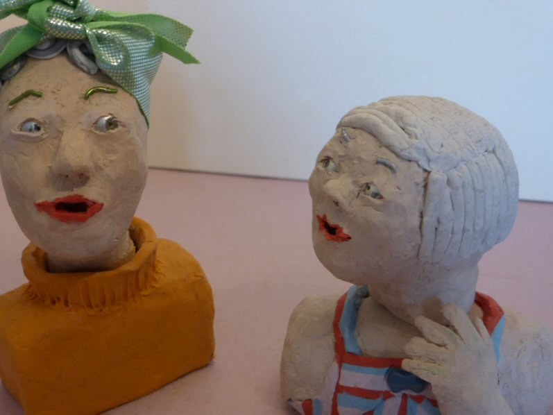 two plasticine heads in conversation