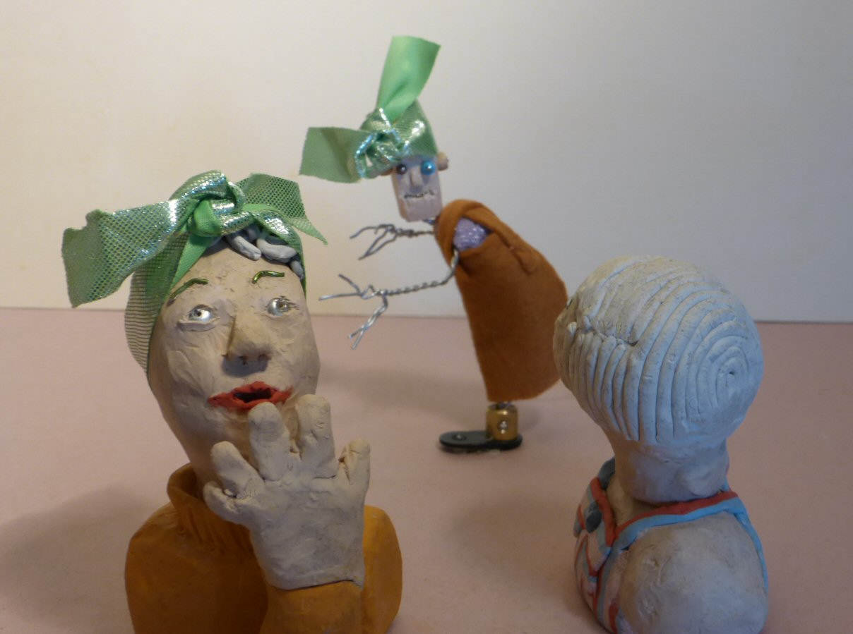 two plasticine heads and wire puppet, two with green headscarves