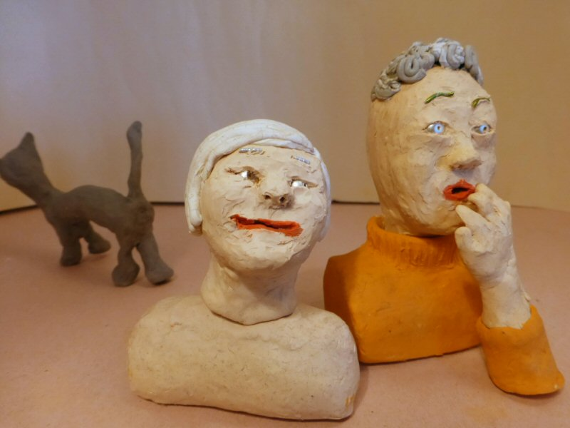 two plasticine heads and plasticine cat