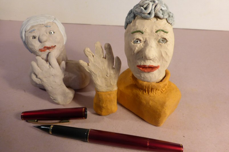 2 plasticine heads and a pen