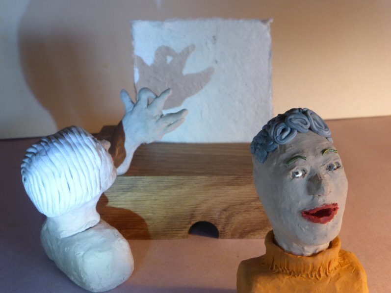2 plasticine heads and shadow play creature