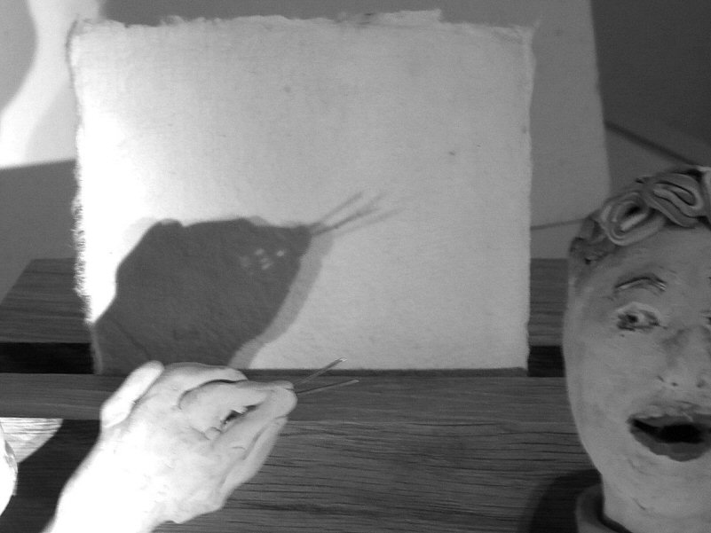 plasticine heads and shadow puppet of snake