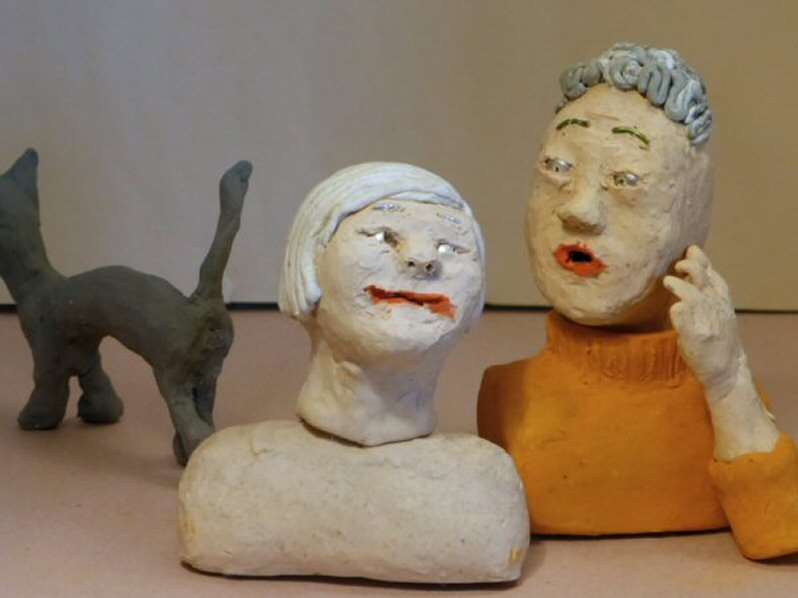 two plasticine heads and cat