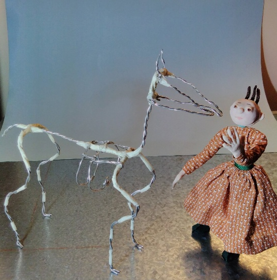 stop motion puppets: doll and wire horse